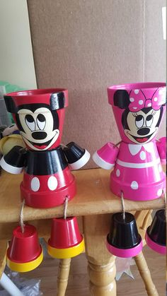 Hand painted Mickey and Minnie Pot Head. These are sold as a pair. If interested in a single Mickey or Minnie, check out my page These products are hand painted clay pots, made into a person. All of my products are sealed, roped, and super glued twice. Custom orders are always welcome.
