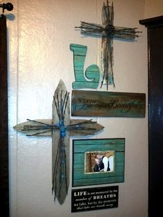 Rustic wall art..Everything is hand made except for the brown sign at the bottom that i already had. Love the look and the outcome.My Daughter made the Letter L and the picture frame from the raw wood you can get at Hobby Lobby for a couple bucks when there on sale,\She used mogpog and scrap book paper. As you can tell I love homemade things in my house, Jackie