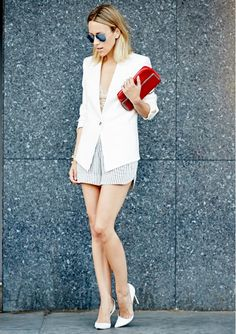 Jacey Duprie of @damselindior  in striped shorts, a white blazer, and white point-toe pumps