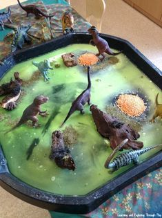 Dinosaur Sensory Swamp Tuff Tray - - Grab the Tuff Tray and create your own Dinosaur Swamp. Full of learning opportunities and textures to explore. Eyfs Activities, Nursery Activities, Dinosaur Activities, Infant Activities, Dinosaur Crafts Kids, Dinosaur Projects, Indoor Activities, Summer Activities, Family Activities