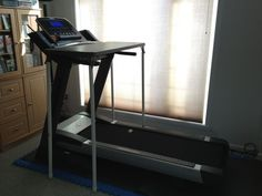 Existing table, legs put into custom-cut PVC pipe. Click this link to read about it: http://www.dowerchin.com/2012/01/23/diy-treadmill-desk-under-50-no-tools-required/