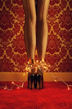 Whoa. The winning photo from Joanna's Wardrobe Leg Art Competition. Sexy. #stockings #twinklelights