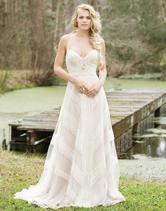 Lillian West style 6468 Nude/Ivory Size 10 Crocheted lace creates a geometric pattern on this halter, racerback, A-line gown with a beautiful hue and chapel length train.