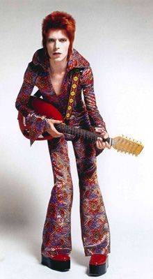 David Bowie's Ziggy Stardust look red hair flares platforms guitar