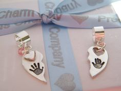 Silver Bespoke Charms by Precious Charm Company, www.preciouscharmcompany.co.uk, Incorporating your loved ones hand, foot, paw or fingerprints and engraving in a beautiful Solid Silver Charm or Keepsake.