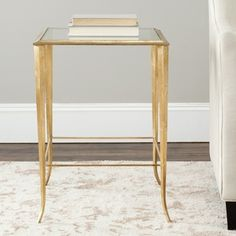 @Overstock - With its brass frame and glass top, this contemporary accent table from the Hidden Treasures Collection will add a touch of elegance to your decor. The piece has a durable design, making it the perfect spot for displaying a favorite lamp or photograph.http://www.overstock.com/Home-Garden/Hidden-Treasures-Glass-Top-Brass-Accent-Table/6811748/product.html?CID=214117 $315.35