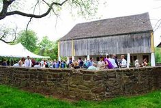 19th c. barn serves as a unique backdrop for an outdoor wedding