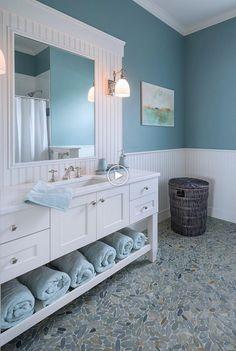 Home Interior Bathroom Blue bathroom with white vanity and pebble bathroom floor.Home Interior Bathroom Blue bathroom with white vanity and pebble bathroom floor Beach House Bathroom, Beach Bathrooms, Beach House Decor, Blue Bathrooms, Master Bathroom, Bathroom Mirrors, Bathroom Cabinets, Bathrooms Decor, Budget Bathroom