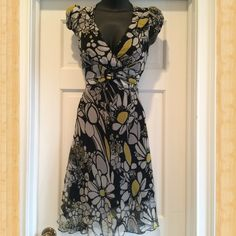 Flower Print Dress Size S/M 100 % Polyester.  Size says S/M.  But it fits a small best.  I bought in Italy from Class-Fashion.  It ties in the back.  Very flattering. Class Dresses