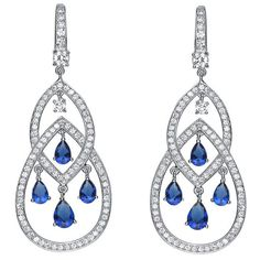 These stunning dangle earrings feature vibrant pear- and round-cut blue cubic zirconia dangling between marquise and pear shapes set with clear cubic zirconia rounds. The earrings are crafted of exquisite platinum over sterling silver.