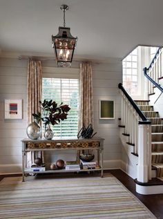 beautiful, huge entry with black banister