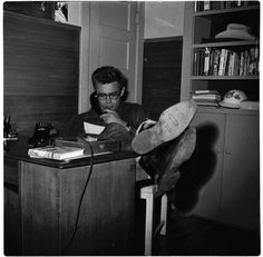 James Dean the Giant on the phone at a desk