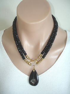Ashira Black Onyx Gemstone Necklace with Luscious Black Agate Druzy Pendant. $245.00, via Etsy.