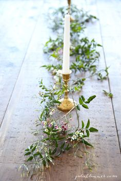 This rustic table setting with plenty of greenery becomes unexpectedly romantic thanks to the tiny touch of pink.