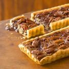 Try the Chocolate-Pecan Tarts Recipe on williams-sonoma.com/