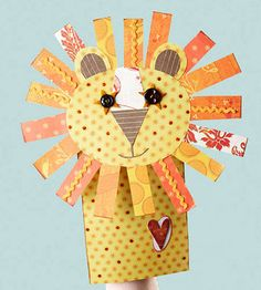 Design by Cathy Blackstone Button eyes and a full mane of paper strips give this lion paper-bag puppet his cheerful charm. Download our free Kid's Corner make-'n'-takes so you can easily print out the instructions and patterns for all of the kid's paper-bag puppets.
