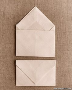 This elegantly simple fold looks appropriate at either an informal meal or a formal one.Envelope Starch and press a napkin. Fold it in half diagonally, letting the bottom edge show about 1 Martha Stewart, Napkin Folding, Colorful Candy, Holiday Tables, Decoration Table, Wedding Decoration, Dinner Table, Simple Designs, Table Settings