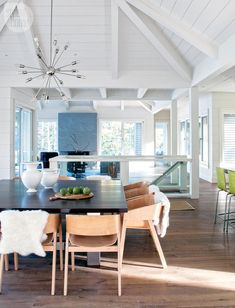 Open space dining room with a neutral-tone and views to the outdoors {PHOTO: Robin Stubbert}
