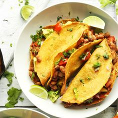 30-minute crispy baked tacos with homemade pinto beans and pineapple sauce! A healthy, satisfying plant-based meal.