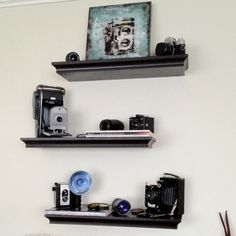 Display Vintage Cameras | Antique camera wall display. Picture on top shelf from Z Galleries and ...
