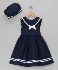 Ahoy, matey! Little sweeties can set sail for fun wearing this nautical outfit. Well-crafted in a classic silhouette, it's got darling details, from its sailor collar to its stripe-trimmed hem. An adorable matching beret lends extra charm. Note: Infant sizes include bloomers.