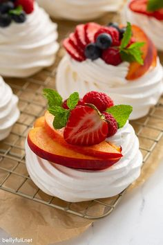 Pavlova is an elegant and beautiful dessert that might look intimidating to make, but is actually incredibly easy! The exterior is crispy, while the inside is soft like marshmallow. Filled with fresh whipped cream and a variety of fruit, this mini Pavlova recipe is a showstopper. Perfect for summer, brunch, after dinner, for the holidays or any occasion! Pavlova Cake, Mini Pavlova, Pavlova Recipe, Meringue Desserts, Trifle Desserts, Easy Desserts, Pampered Chef Recipes, Gourmet Recipes, Gourmet Foods