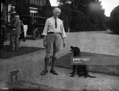 London, England, 1929, Founder of the Scout movement Sir Robert Baden Powell with his pet dog outside his London home