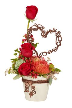 A biodegradable ECOssential Container and some Rustic Wire give this charming arrangement a natural, organic look