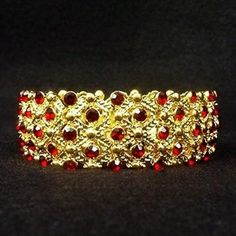Another gift from JFK was this 18k gold and ruby wide bangle bracelet.