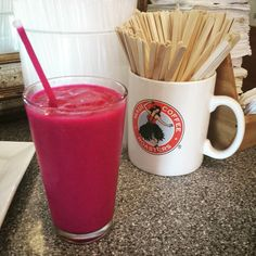 Grabbing a Piyata Smoothie from @mauicoffeeroasters before an afternoon of meetings. It's made with dragonfruit which gives it the vibrant pink/purple color. Yum!