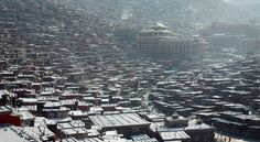 Serthar Wuming Buddhist Study Institute - An elevated view of monastics dormitories is seen at the Serthar Wuming Buddhist Study Institute on Apill 30, 2016 in the Tibetan autonomous region of China. The Wuming Buddhist Study Institute is located in Larung Gar Monastery on an altitude of 3,700 metres (approx. 12,100 feet). The institute has the largest conglomeration of monks and nuns in Tibet, with over 40,000 monastics from the Tibet Buddhism Nyingma School, Gelug School, Sakya School and…