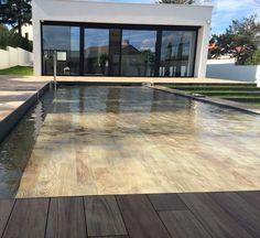 la piscine fond mobile qui devient terrasse cliquez sur. Black Bedroom Furniture Sets. Home Design Ideas