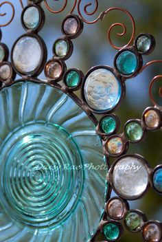Suncatcher. Depression style glass plate with glass nuggets and copper filigree.