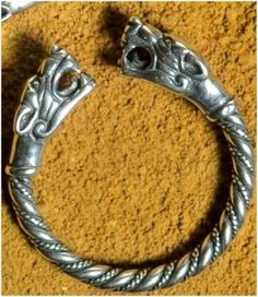 Silver ring with heads of viking wolves. Diameter of this ring is adjustable. Design of a wolf's head is taken from a Wolf's Cross - Thor's Hammer that was found in Iceland (locality of Fossi, X.-XI. Century). Weight: 4 - 5 g.