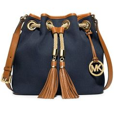 MICHAEL MICHAEL KORS Marina Canvas Medium Messenger Bag ($198) ❤ liked on Polyvore featuring bags, navy, canvas courier bag, blue canvas bag, tassel bag, navy messenger bag et blue messenger bag