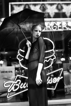 Love this very theatrical shot by Charlie Paille, reminiscent of Blade Runner. The black and white makes even a burger backdrop look eerily seductive.