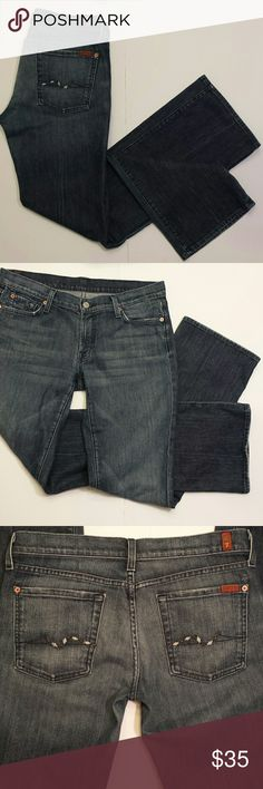 """7 Seven for all Mankind Bootcut Jeans 7 Seven for all Mankind Bootcut jeans. Signature squiggle pocket with an argyle diamond twist design! Medium blue wash jean with whisker washing throughout thigh. Really soft denim. Preowned in great condition with no rips, holes, tears or stains. Clean original hems. 98% cotton, 2% lycra.  Measurements  Waist 17 and 3/4"""" Inseam 33.5"""" Rise 8"""" Leg opening 9.5"""" 7 For All Mankind Jeans Boot Cut"""