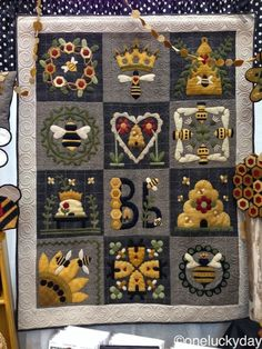 Blessed Bee is a charming quilt featuring hand-dyed wool applique on light and dark gray flannel back Motifs Applique Laine, Wool Applique Quilts, Wool Applique Patterns, Wool Quilts, Felt Applique, Mini Quilts, Quilt Patterns, Aplique Quilts, Wool Embroidery