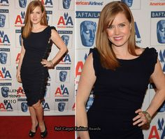 Amy Adams wears a simple navy Azzaro dress with a twist, as it has a ruched detail going down one side.