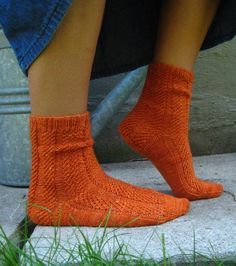 Inspired by a fabulous colorway of hand-dyed sock yarn called Roasted Carrot, and a rather carrot-y sort of faux-cable pattern stitch, these socks are elegant yet easy to work.And they don't have to be orange - carrots come in many colors, you know.Although the dyer is no longer working, you can substitute any 100gm skein of 3-ply sock yarn.Pattern is worked top down and is written to be worked on your choice of DPNs, Magic Loop or Two Circulars.