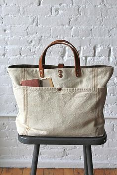 era Farm Feed Sack Pocket Tote - FORESTBOUND - A responsive Shopify theme Love this! Have some old feed sacks, going to do this Sacs Tote Bags, Reusable Tote Bags, Lv Bags, Feed Sacks, Large Handbags, Cheap Handbags, Tote Handbags, Kinds Of Shoes, Fabric Bags