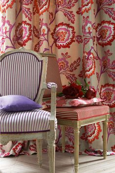 Manuel Canovas' Samira (drapes), Sana (chairs), Nura (pillow on left chair), and Siltan (pillow on right chair)
