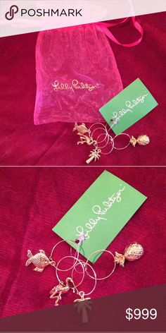 NWT Lilly Pulitzer drink charms Set of four gold tone wine glass charms with original tag and bag. Packaged as shown. Hostess gift for NYE! Bundle and save and gift!! Lilly Pulitzer Accessories