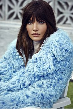Lily Aldridge looking SO glam in a fuzzy blue coat and messy bangs