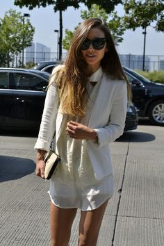 Killing it in a statement making all white outfit at #NYFW @rumineely from Fashion Toast demonstrates how perfect monotone layering is for staying chic in the New York heat!  WGSN street shot, New York Fashion Week.