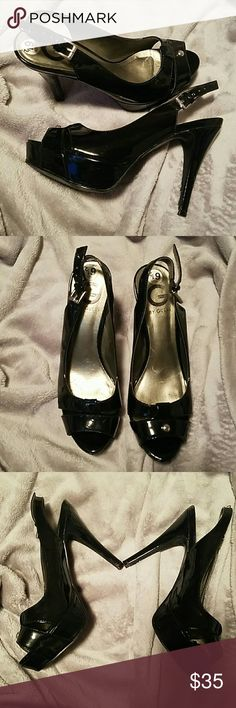 Guess patent leather platform sling back peep toe Beautiful pre-owned 4.5 to 5 inch black heels.   These have been worn a few times but are in great pre-owned condition. Guess Shoes Heels