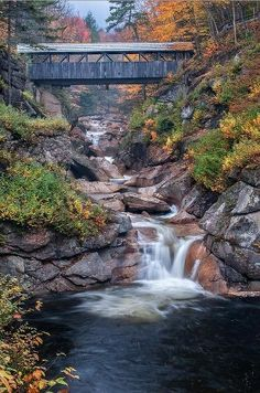 High in the White Mountains of New Hampshire in Franconia Notch the Sentinel Pine Covered Bridge spans the Pemigewasset River and the natural formation known as The Pool.