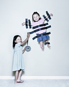 Creative dad takes crazy photos of daughters.