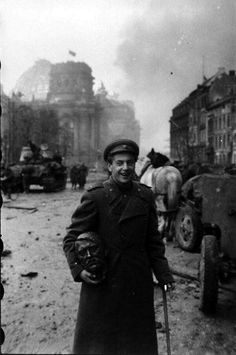 A Russian soldier carries a statue head of Adolf Hitler, Berlin, May, 1945