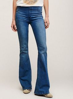 badfc7a0c596 Stretchy pull-on flared jeans by Free People with faux closure in front.
